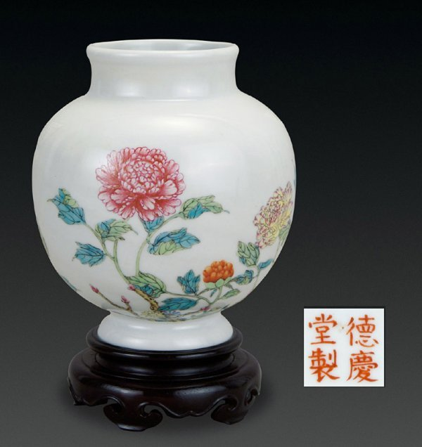 1270: a hand-painted porcelain jar in famille rose with