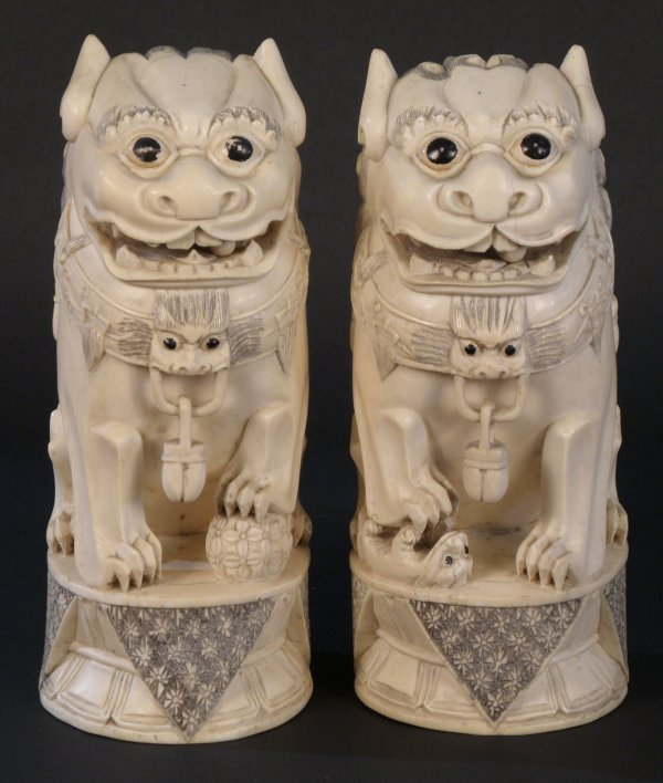 13: A Chinese pair of ivory figure of lions