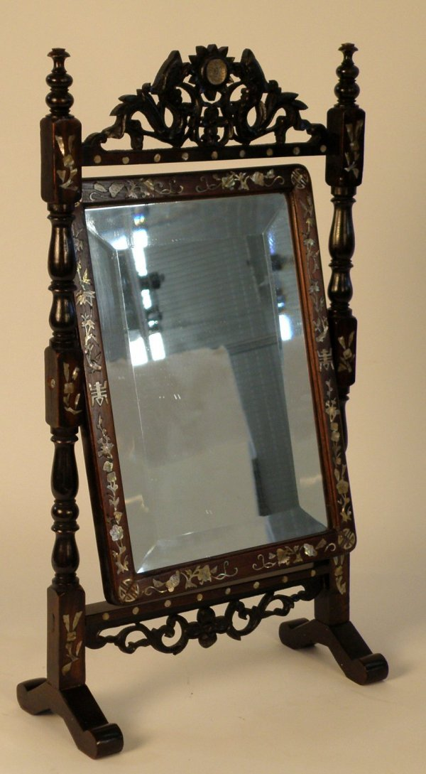 22: A Chinese Qing Dynasty hongmo beveled table mirror