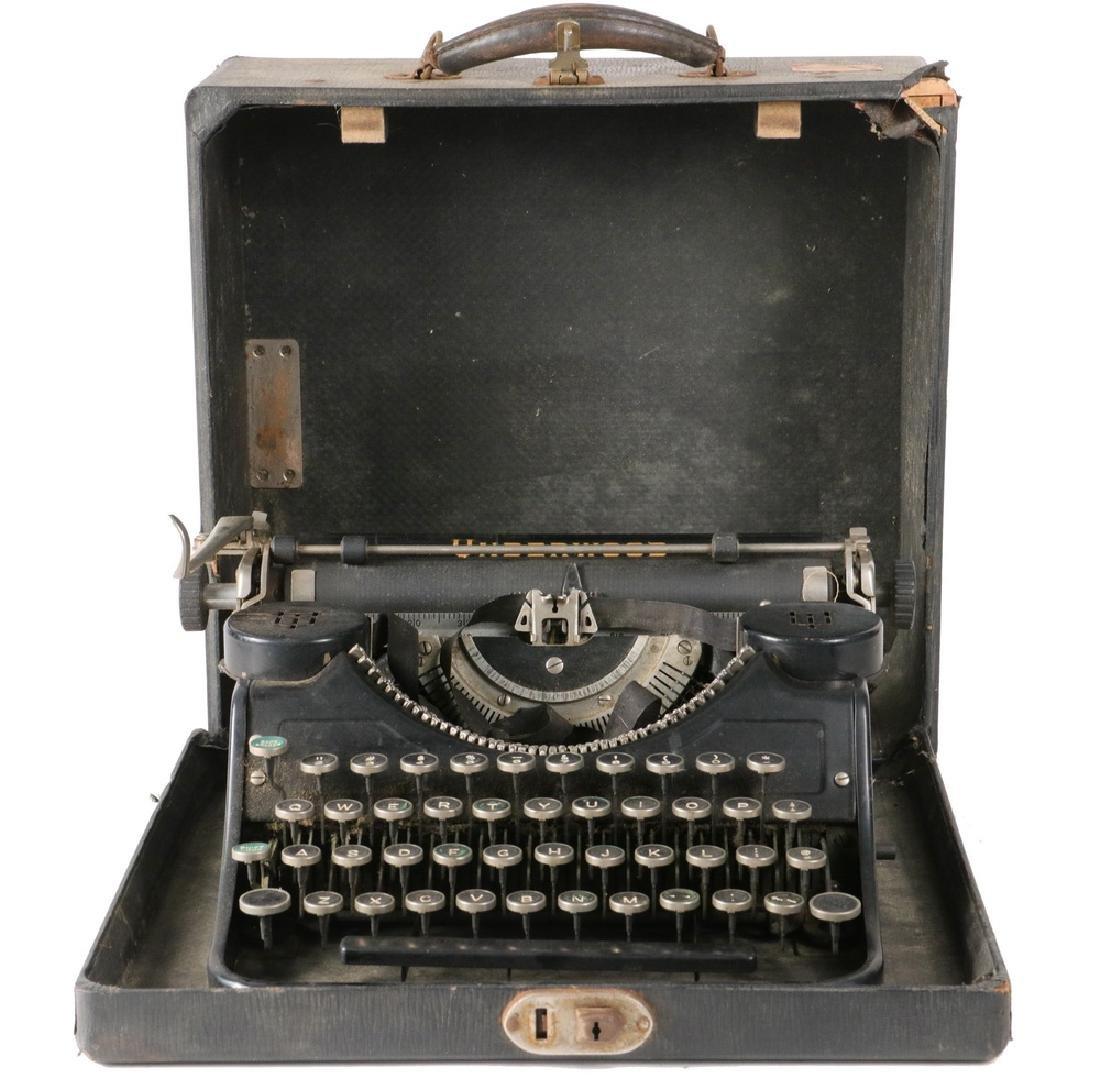 CASED PORTABLE TYPEWRITER