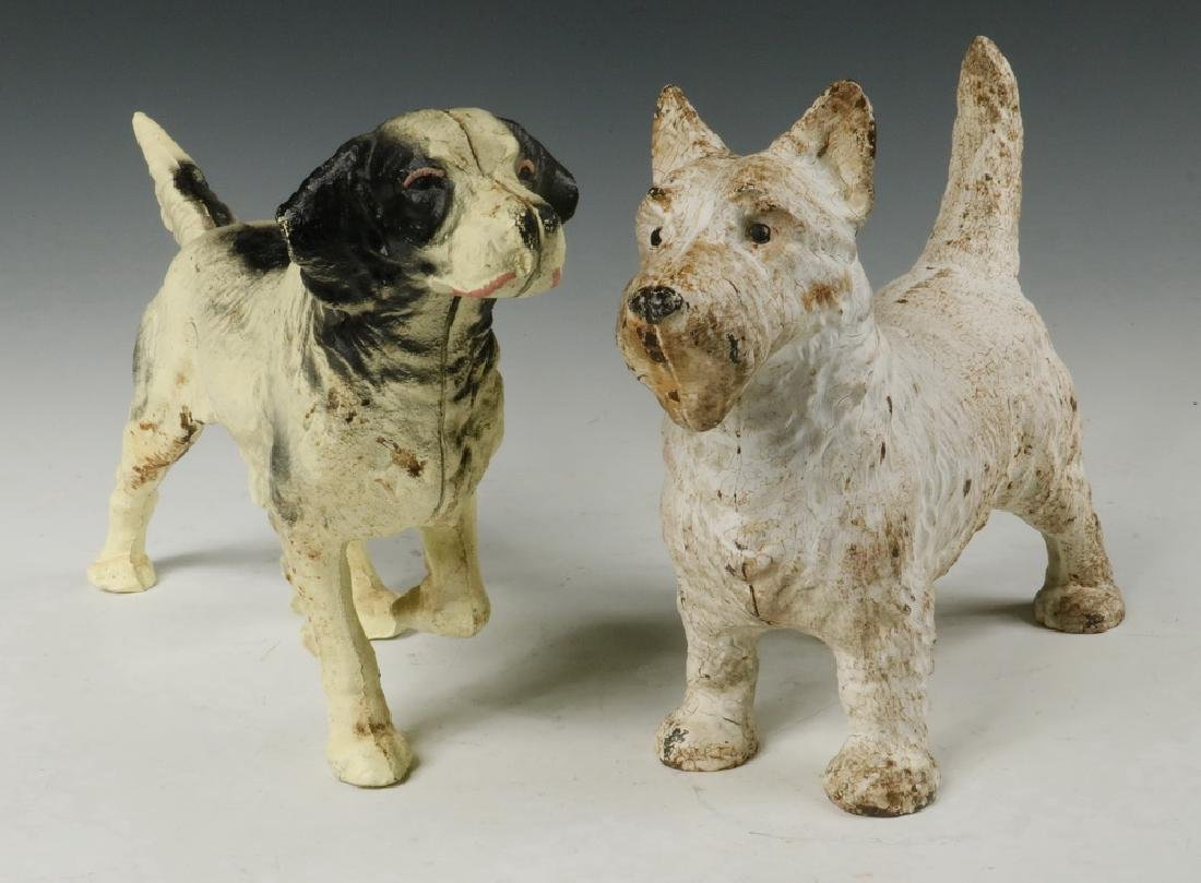 (2) CAST IRON DOG DOORSTOPS