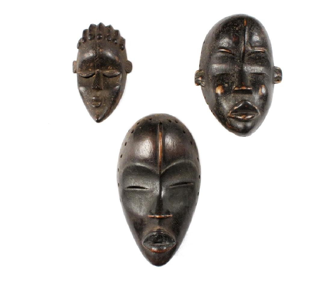 (3) SMALL AFRICAN MASKS