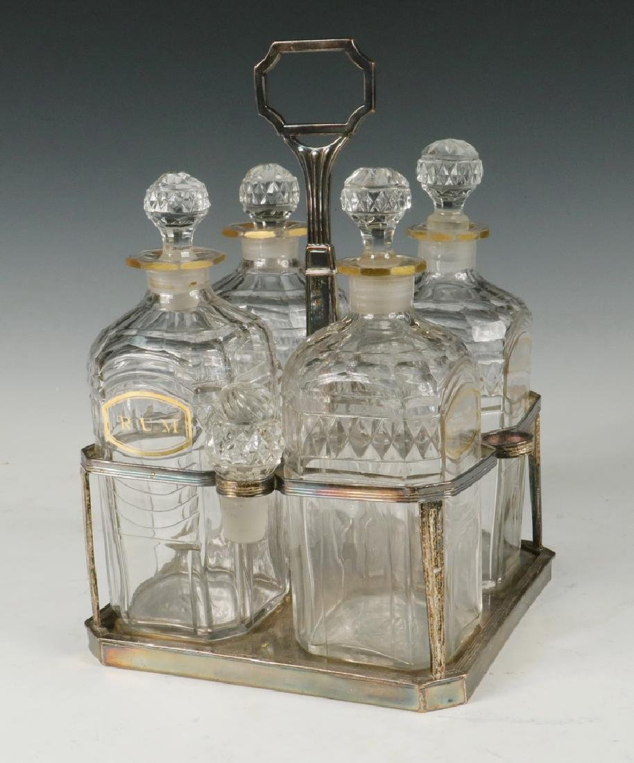 (4) EARLY DECANTERS IN SILVER PLATED STAND