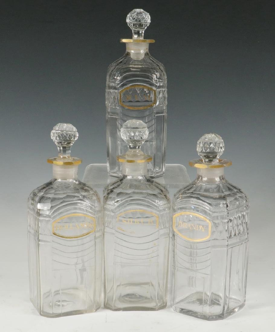 (4) EARLY DECANTERS IN SILVER PLATED STAND - 2