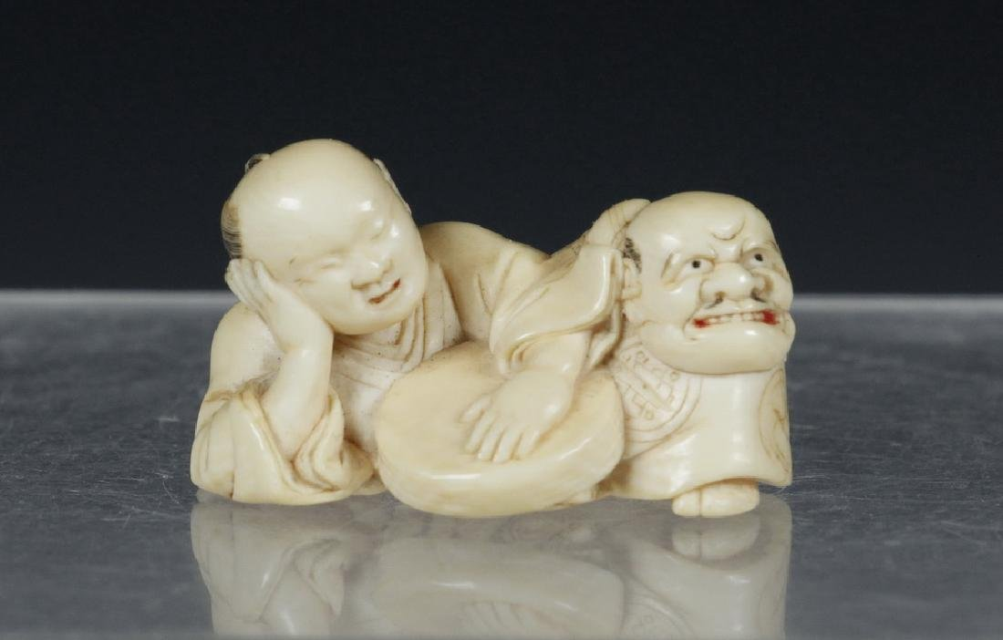 19TH C. JAPANESE CARVED NETSUKE OF A RESTING NOH