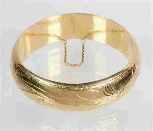 HINGED BANGLE BRACELET IN 18K YELLOW GOLD