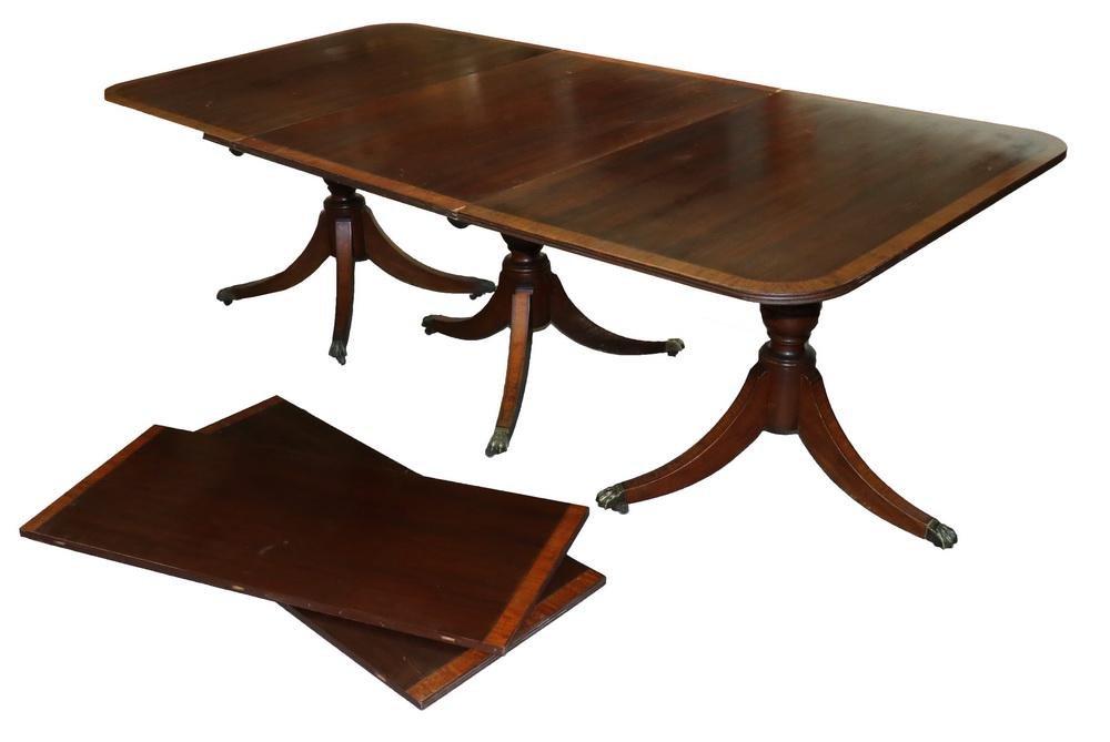 20TH C. MAHOGANY TRIPLE PEDESTAL DINING TABLE