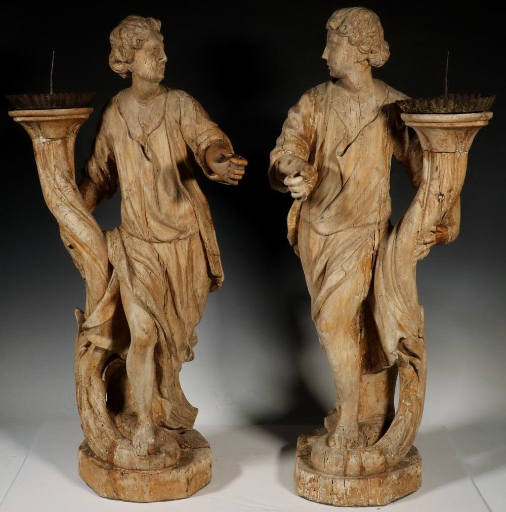 PR OF CONTINENTAL CARVED WOOD FIGURAL PRICKETS
