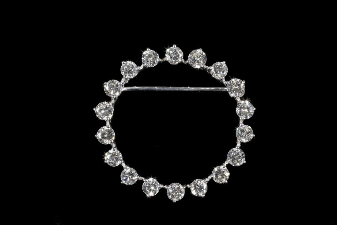 CIRCULAR DIAMOND BROOCH IN 14K GOLD