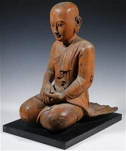 18TH C. BURMESE TEMPLE CARVING OF A BUDDHIST ACOLYTE
