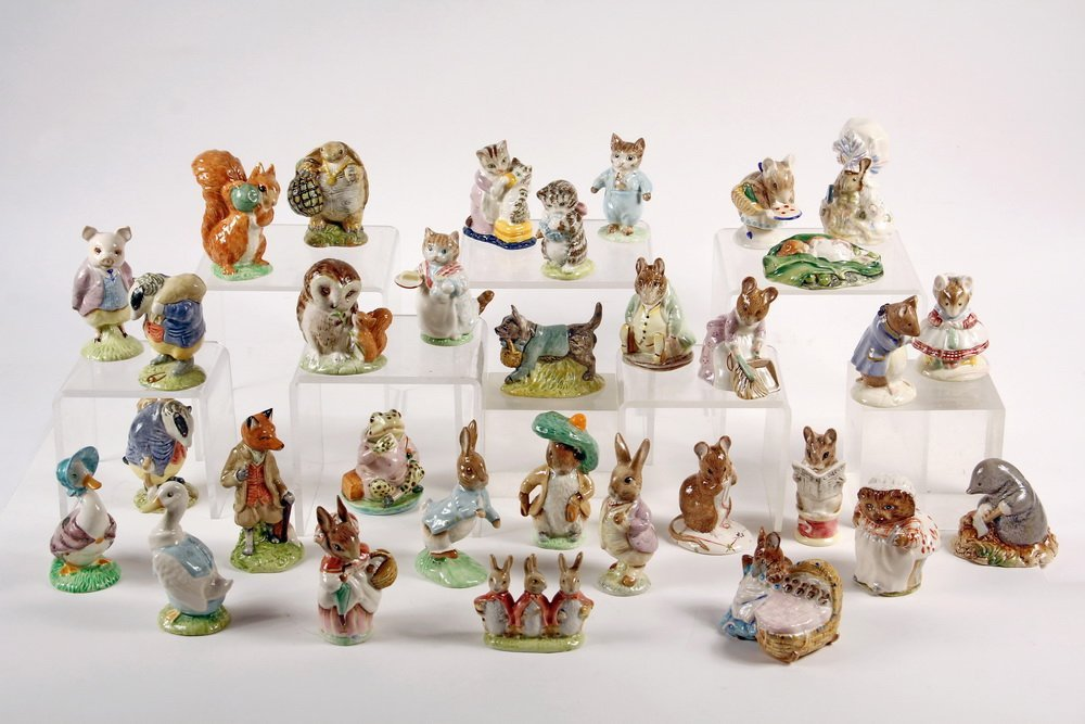 COLLECTION OF (32) BEATRIX POTTER PORCELAIN FIGURINES