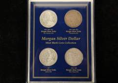 COINS - (4) Silver Dollars, four different mints.