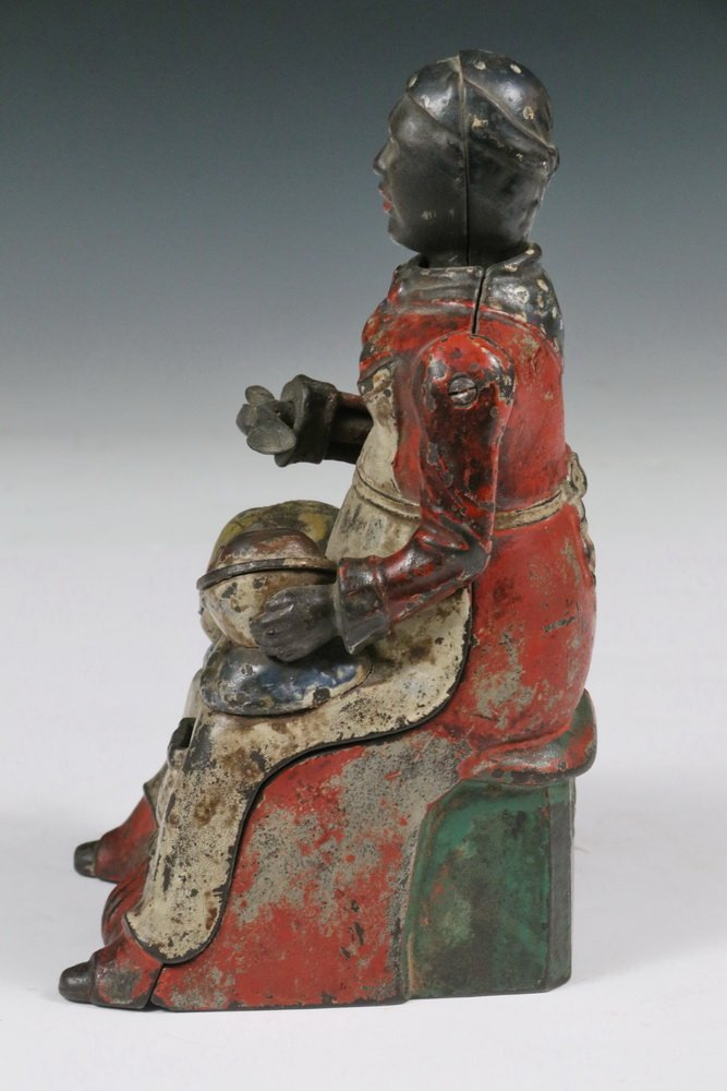 """MECHANICAL BANK - Painted Cast Iron """"Mammy with Spoon"""" - 5"""