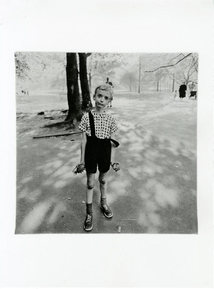 123: DIANE ARBUS - Child with a Toy Hand Grenade in