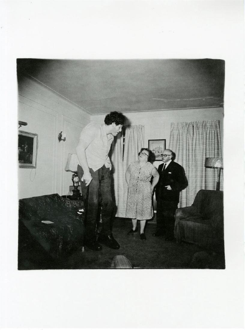 300: DIANE ARBUS - Jewish Giant at Home with His