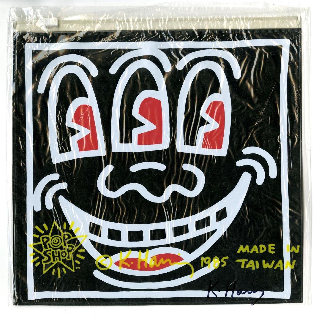 702: KEITH HARING - Three-Eyed Smiley Face