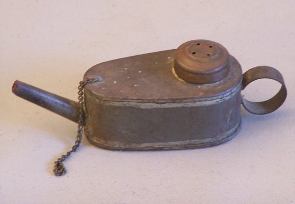 9: Antique tin whale oil lamp