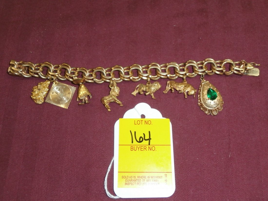 164: 14kt Gold Charm Bracelet with 7 charms
