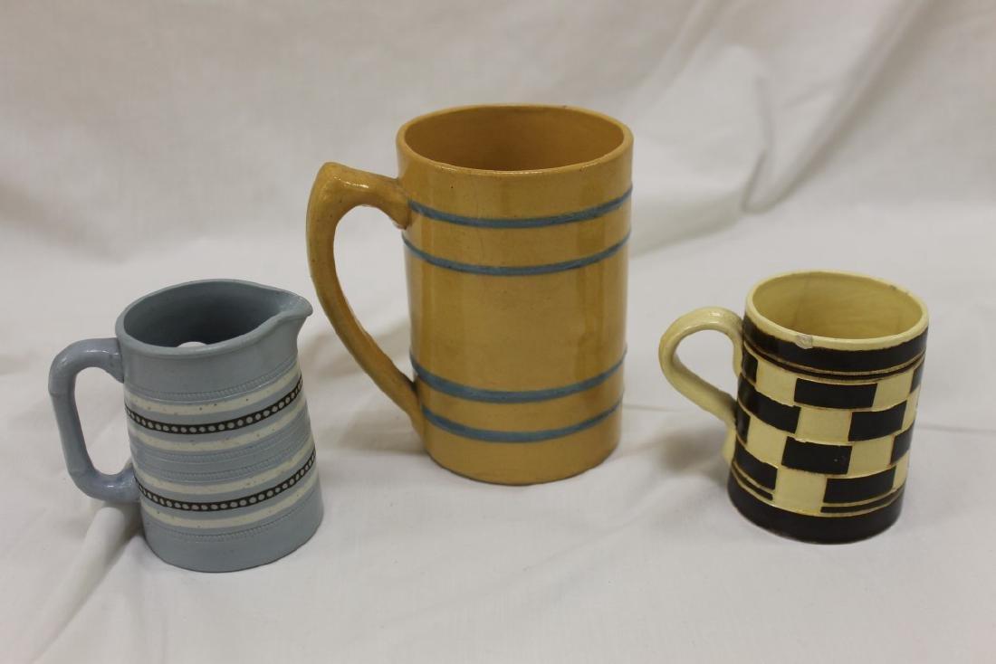 "Yellow ware mugs:  3"" brown and yellow checkerboard mug"