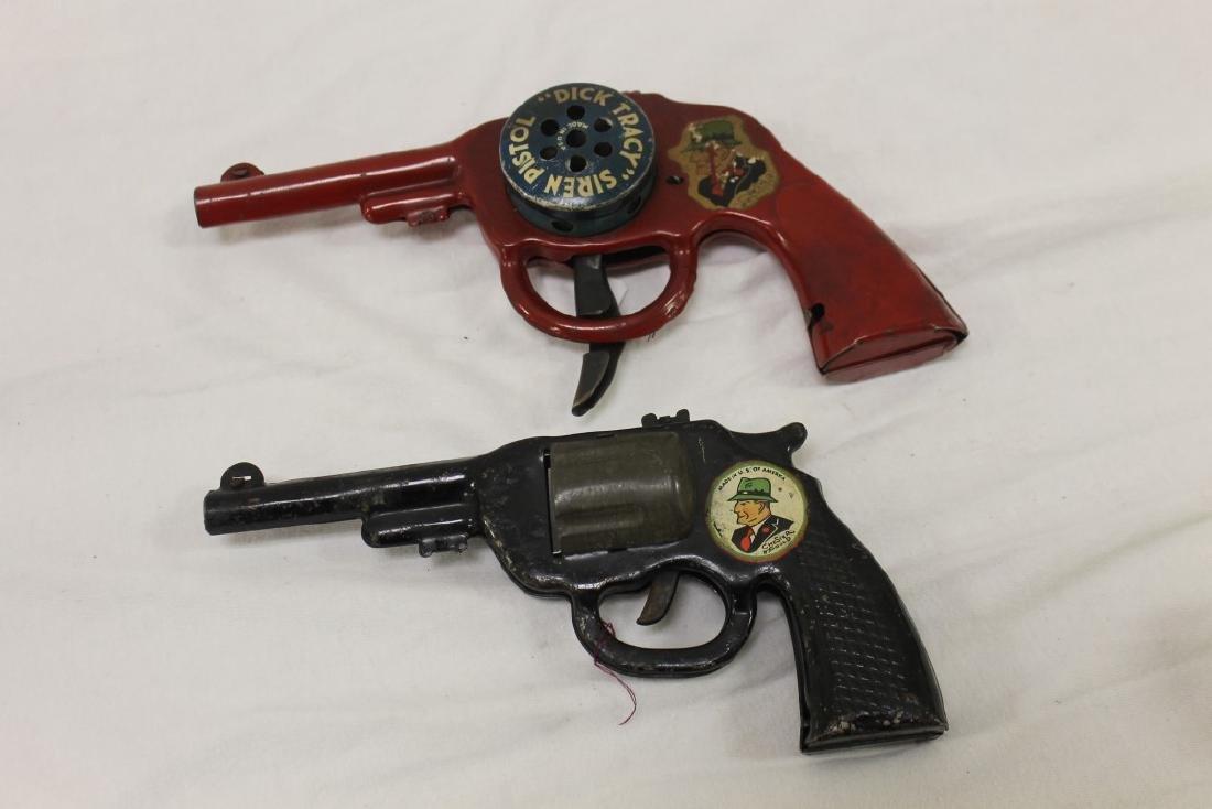 Dick Tracy Siren Pistol and pop gun.  Both painted
