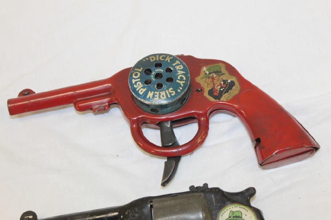 Dick Tracy Siren Pistol and pop gun.  Both painted - 2