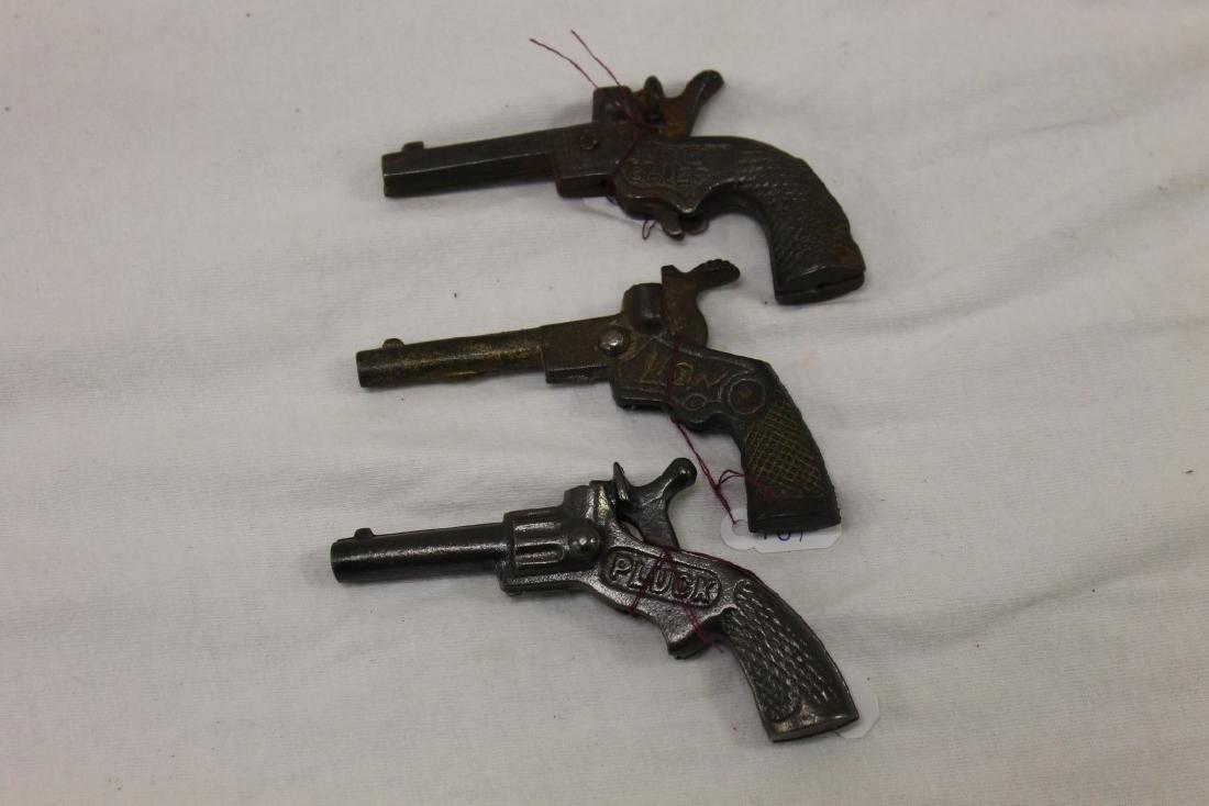 """Cast iron cap guns:  Dent """"Big Chief"""", c. 1930, 3 1/2"""","""