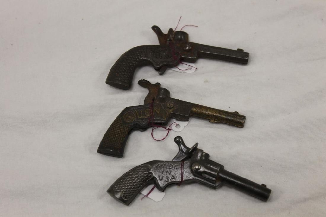 """Cast iron cap guns:  Dent """"Big Chief"""", c. 1930, 3 1/2"""", - 2"""