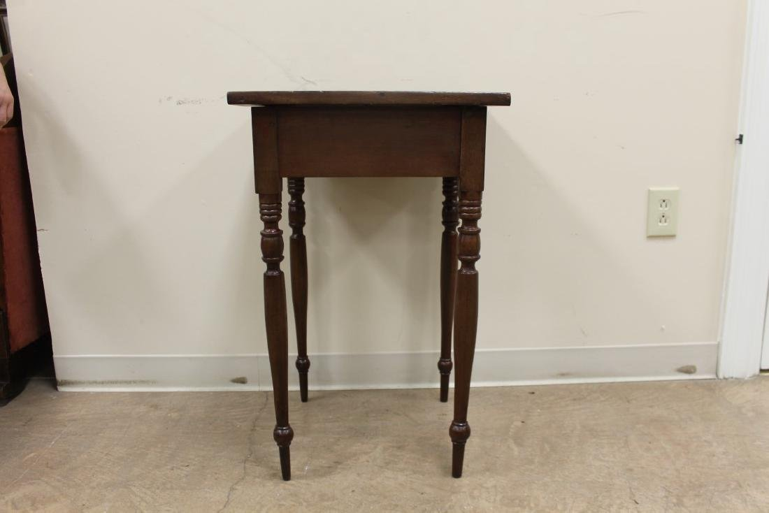 Walnut stand table with finely turned legs and a solid