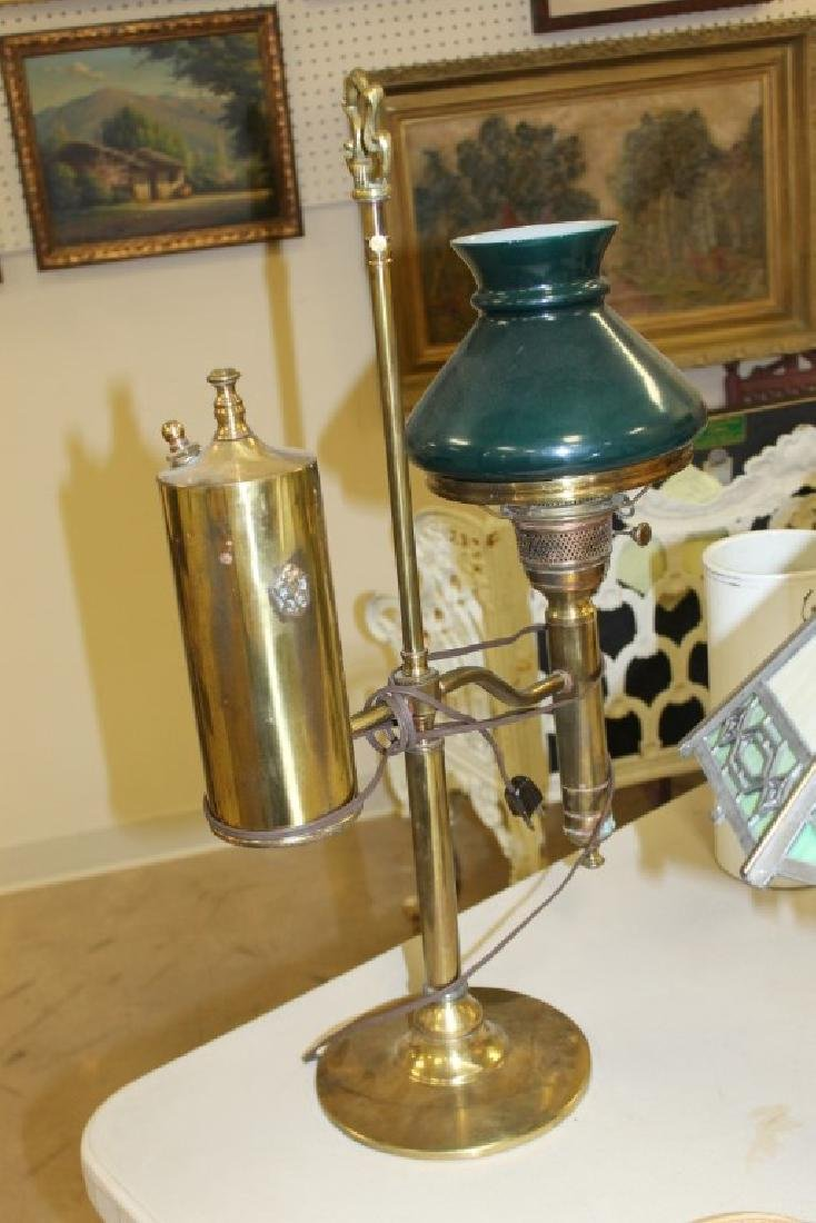 Brass student lamp with cased green shade, marked