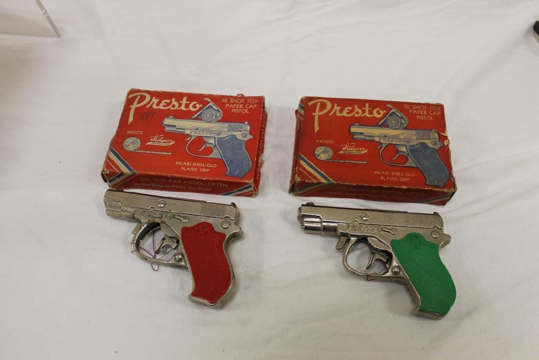 "(2) Kilgore ""Presto"" 50 Shot cast iron cap pistols, c."