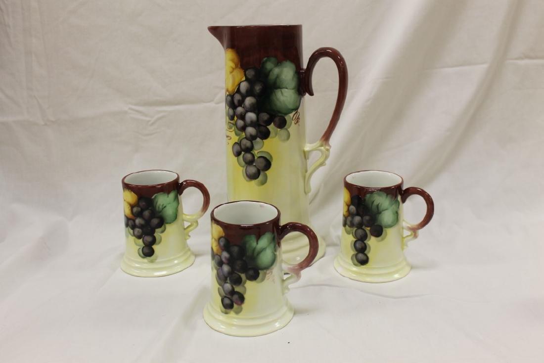 "M.Z. Austria grape decorated 12 1/2"" tankard with minor"