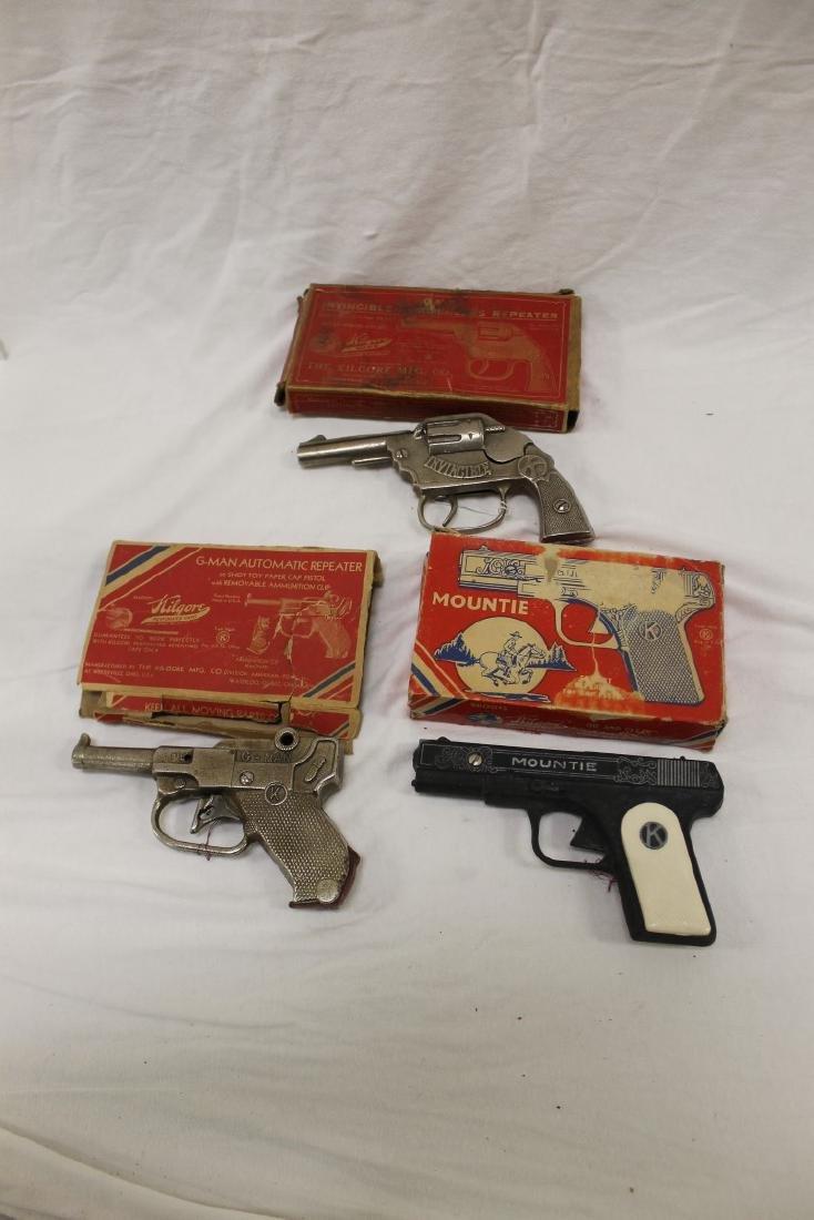 """Kilgore cap guns: """"Invincible"""" and """"G-Man"""" cast iron,"""