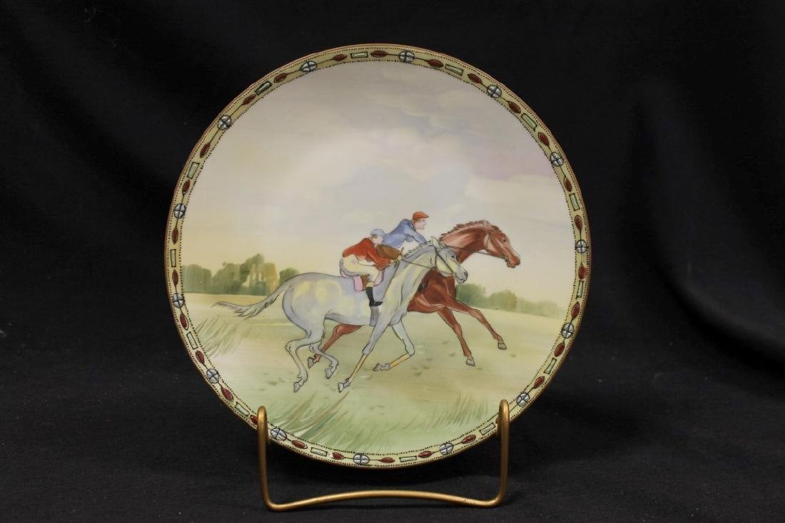 """Nippon Green M in wreath 9"""" with horse race scene."""