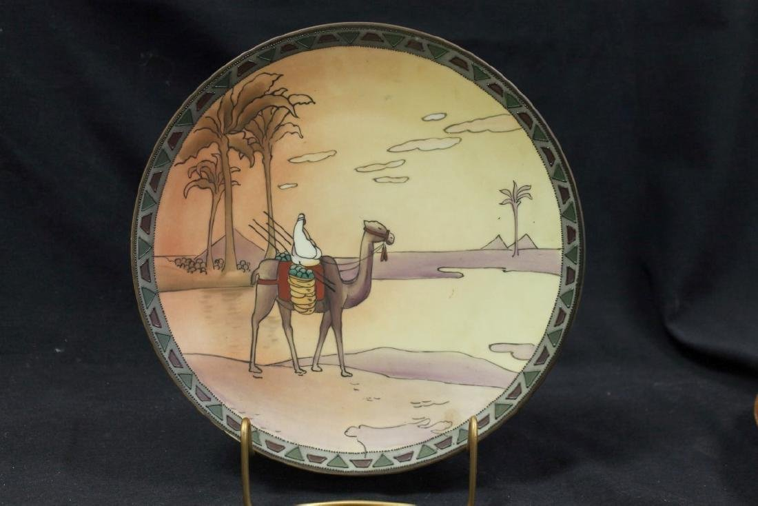"Nippon Green M in wreath 10"" plaque with Man on camel"