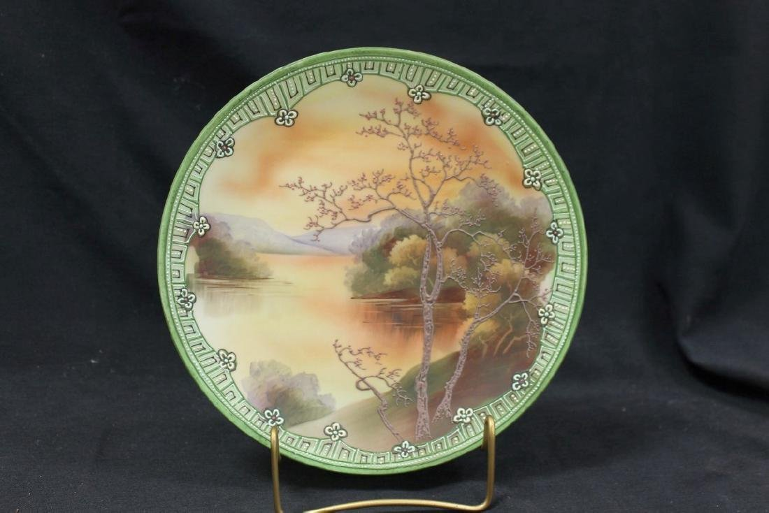 "Nippon blue Maple Leaf 10 1/8"" round plaque with Galle`"