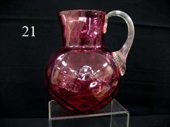 21: Cranberry coin dot water pitcher with clear reeded