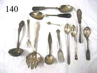 140: Coin and sterling silver - (2) coin serving spoons