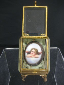 9: Jewelry casket with oval brooch with an angel.  Face