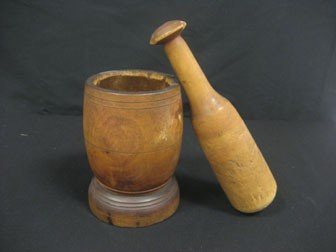 21: Turned wooden mortar and pestle.  Two notches on pe