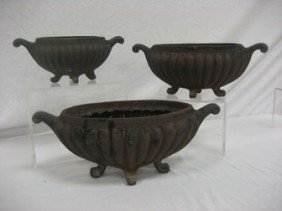 1: (3) Iron ribbed flower pots.