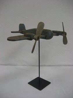 6: Wooden airplane on stand in blue paint.