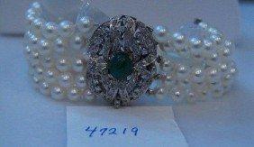 12: Five strand cultured pearl bracelet.