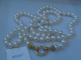 13: Opera length pearl necklace.