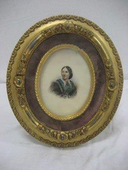 173: Oval framed portrait on milk glass of a lady.