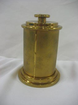 "10: Brass cigarette dispenser.  5 7/8"" tall when closed"