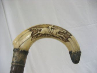 7: Cane/walking stick:  Carved bone/ivory handle with 8