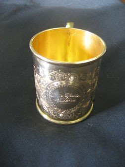 22: 14k yellow gold child's cup marked H. Semken.  Engr
