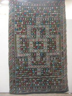 "1: African rug.  94"" long, 55 1/2"" wide."