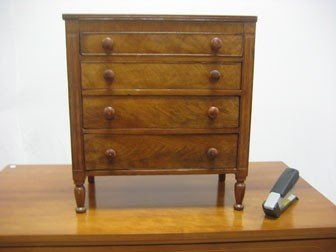 19: Miniature cherry four drawer chest with cock beadin
