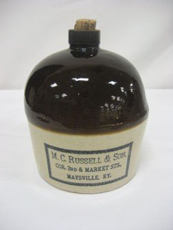 21: KY stoneware advertising jug - M.C. Russel & Son CO